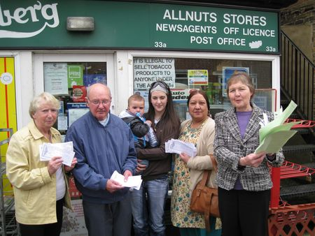 Cllr Janet Whitehouse, Shanhaz Javid and local residents show off the petition signatures calling for the re-opening of Allnutts Post Office