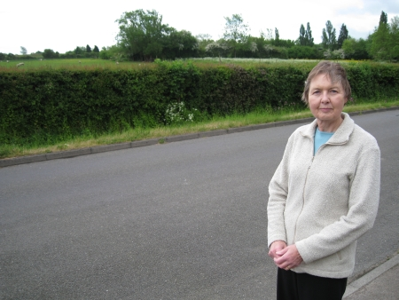 Liberal Democrat district councillor Janet Whitehouse with proposed Gypsy site at Woodside, Thornwood in the background