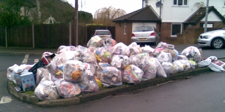 Recycling sacks awaiting collection in Beaconfield Road, Epping